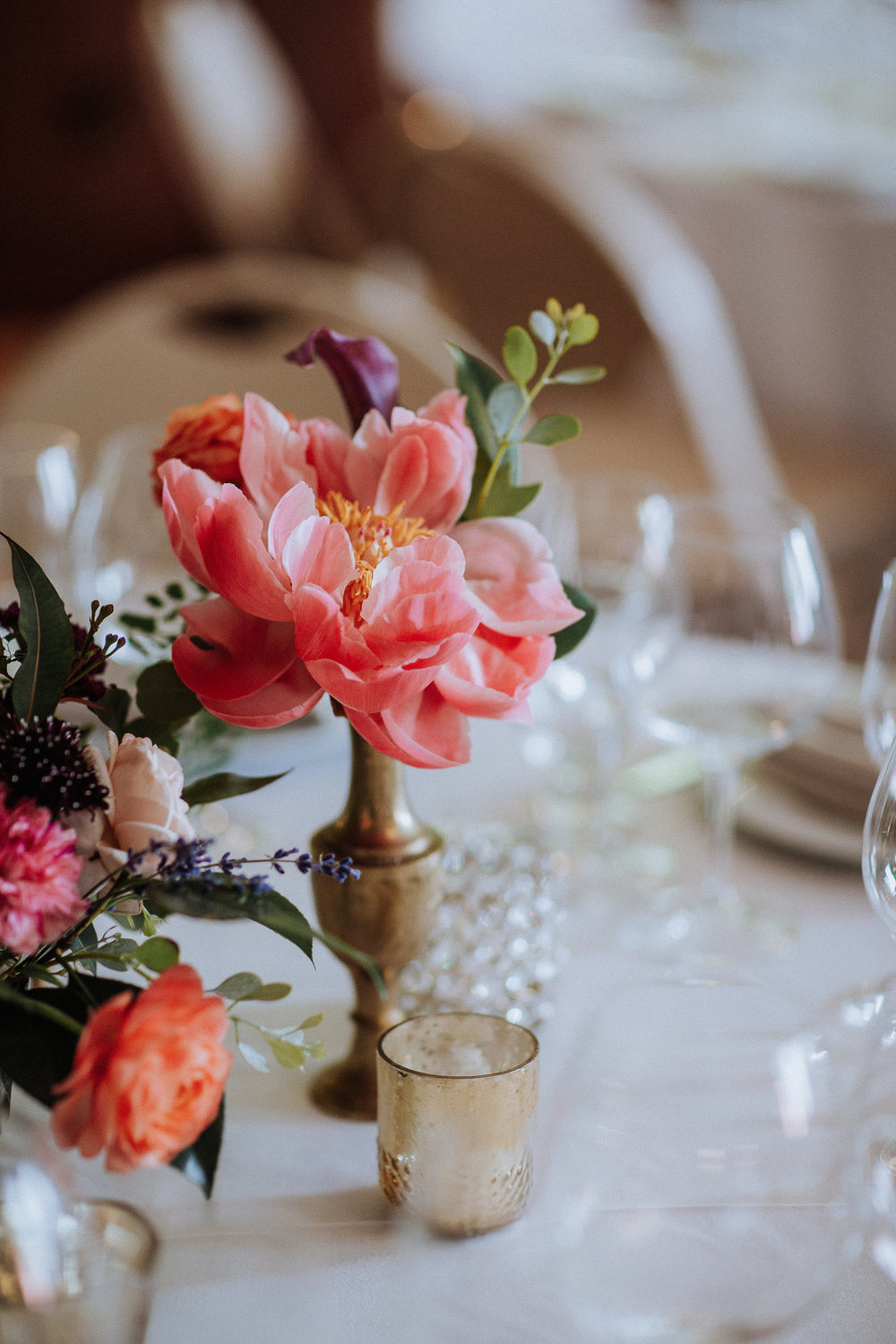 Bud vases with colorful flowers and candles by Venn Floral photographed by Gretchen Gause in Northern California at Villa Chanticleer.