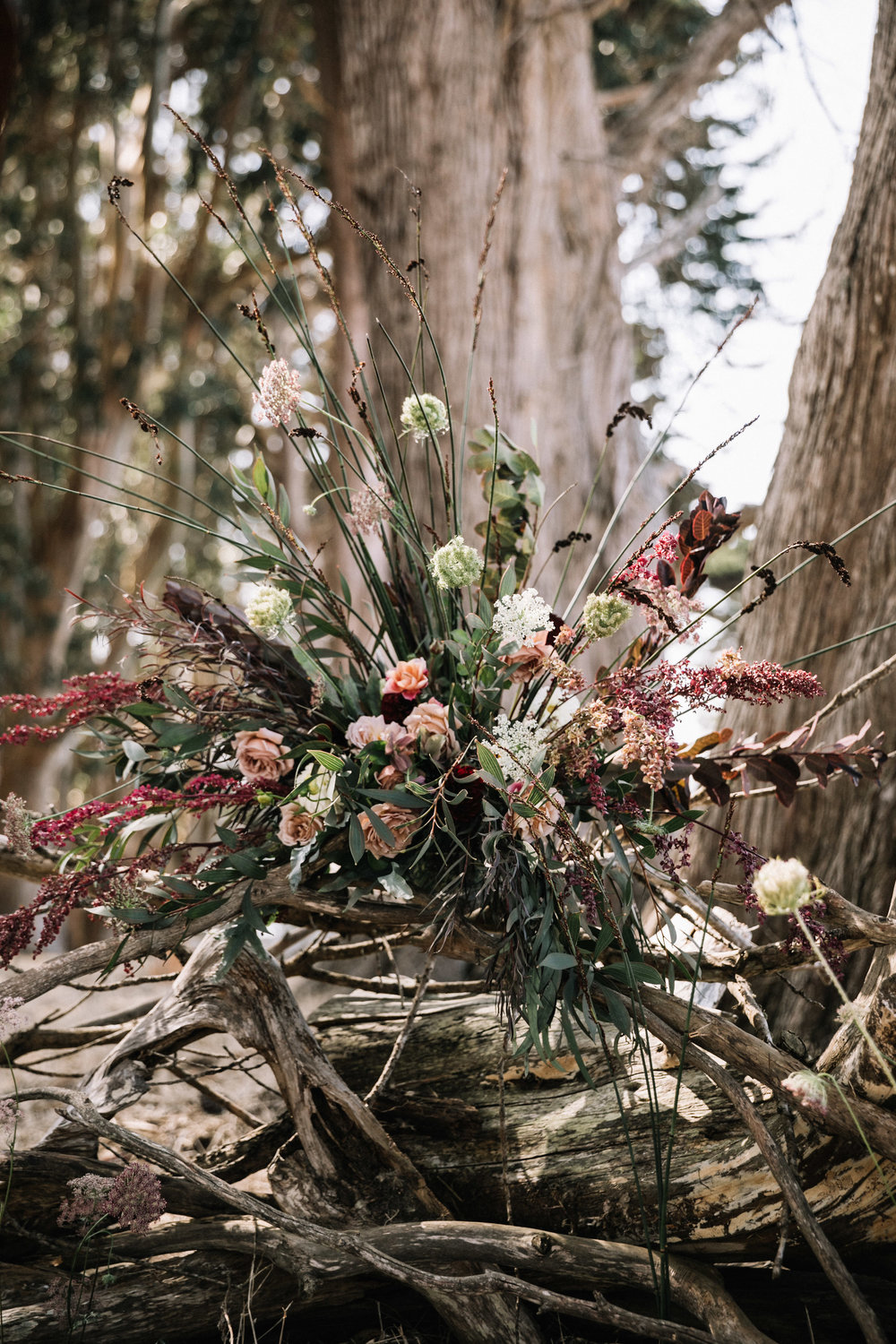 Elegant and wild ceremony arrangement by Venn Floral photographed by Lucille Lawrence in West Marin at Straus Home Ranch.