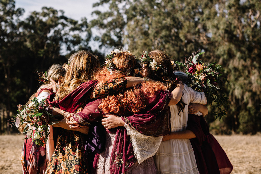 Flowers for bridesmaids in amethyst, gold, and burgundy for a coastal autumn wedding in West Marin by Venn Floral photographed by Lucille Lawrence at Straus Home Ranch.