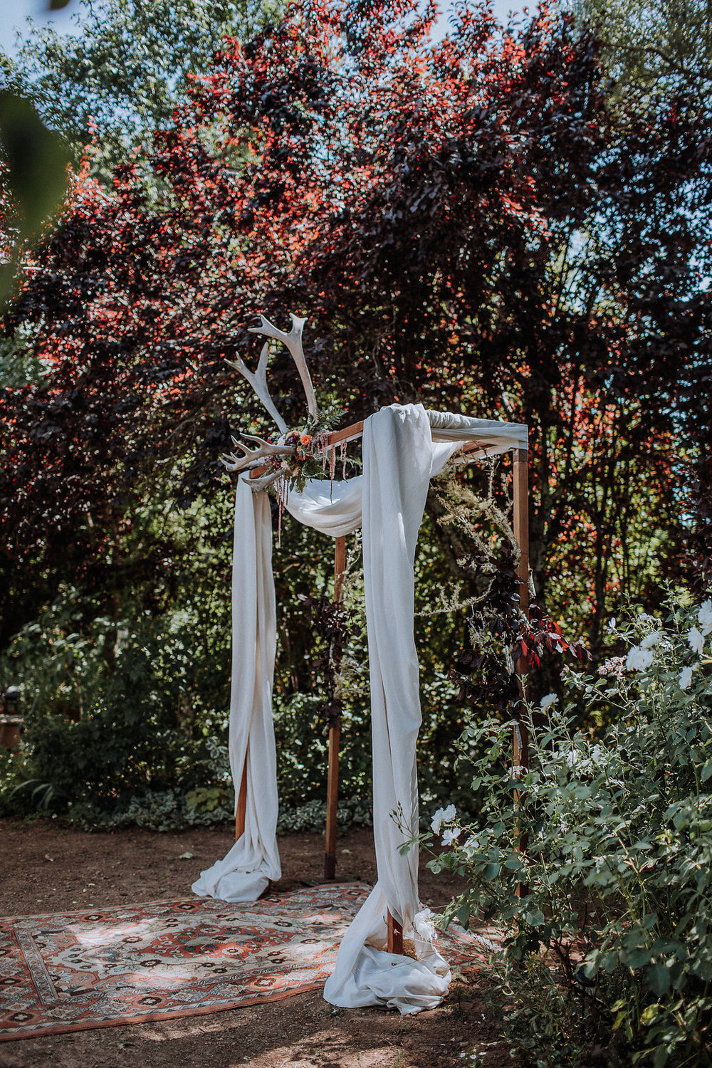 Our most sacred space. Rowan Farm wedding in the garden we harvest so many of our materials from year round. Ceremony structure for Camille's sister using antlers found on the property and sonoma grown flowers. Photo by  Gretchen Gause .