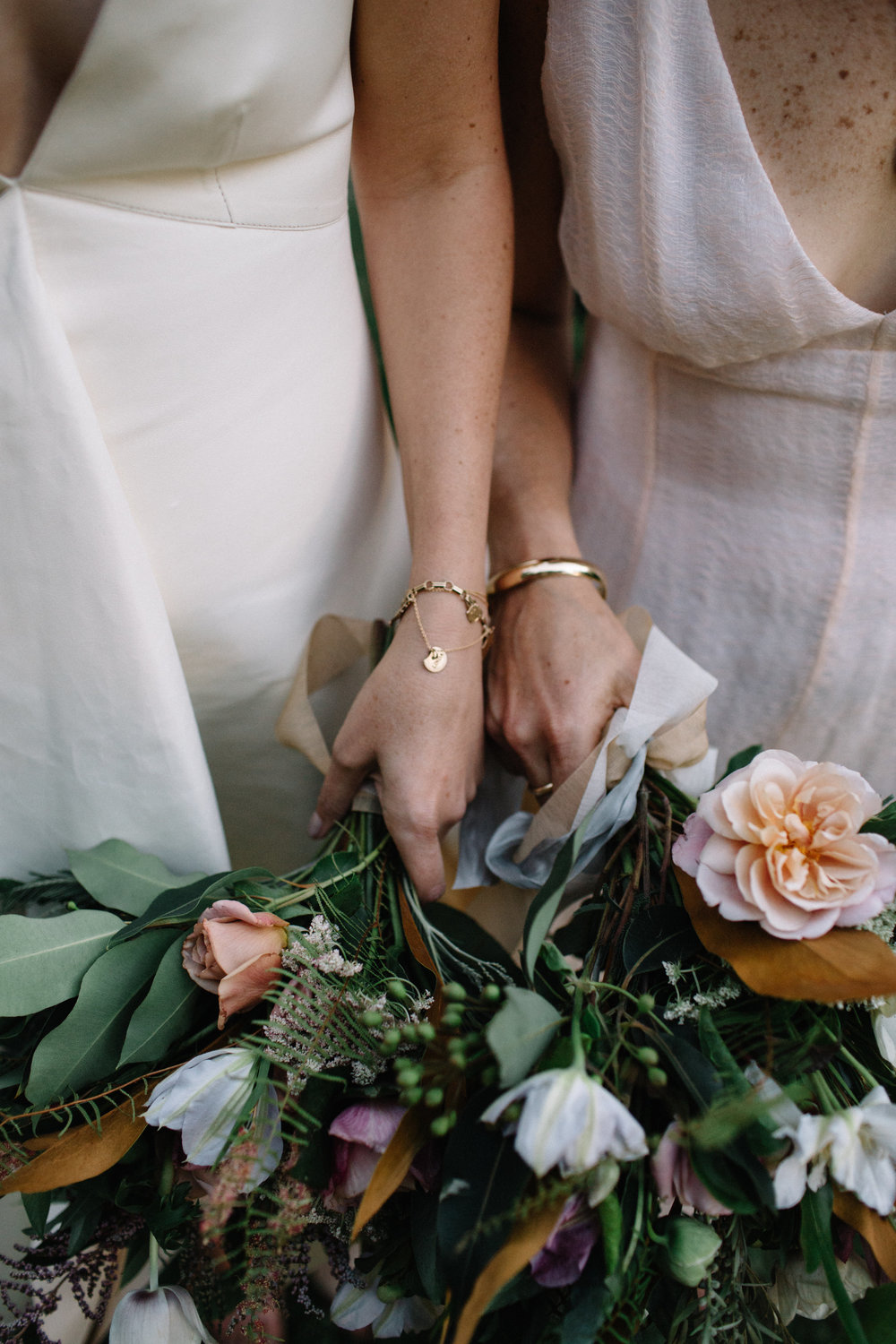 The sweetest B + E with their bouquets, photographed by  Lucille Lawrence .