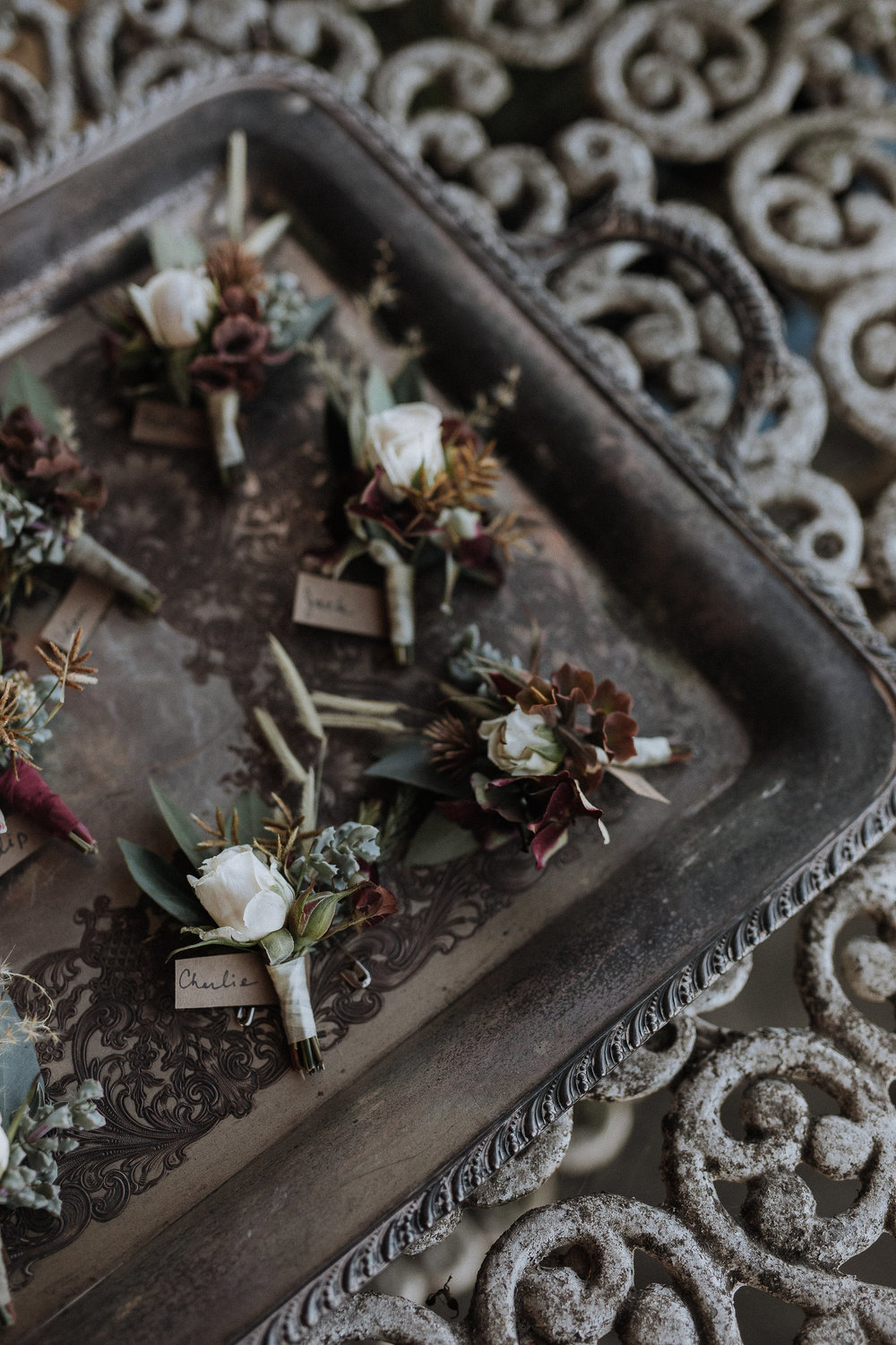 Textural boutonnieres with interesting accents in shades of dusty rose, sage, and gold by Venn Floral at Olympia's Valley Estate photographed by Gretchen Gause.