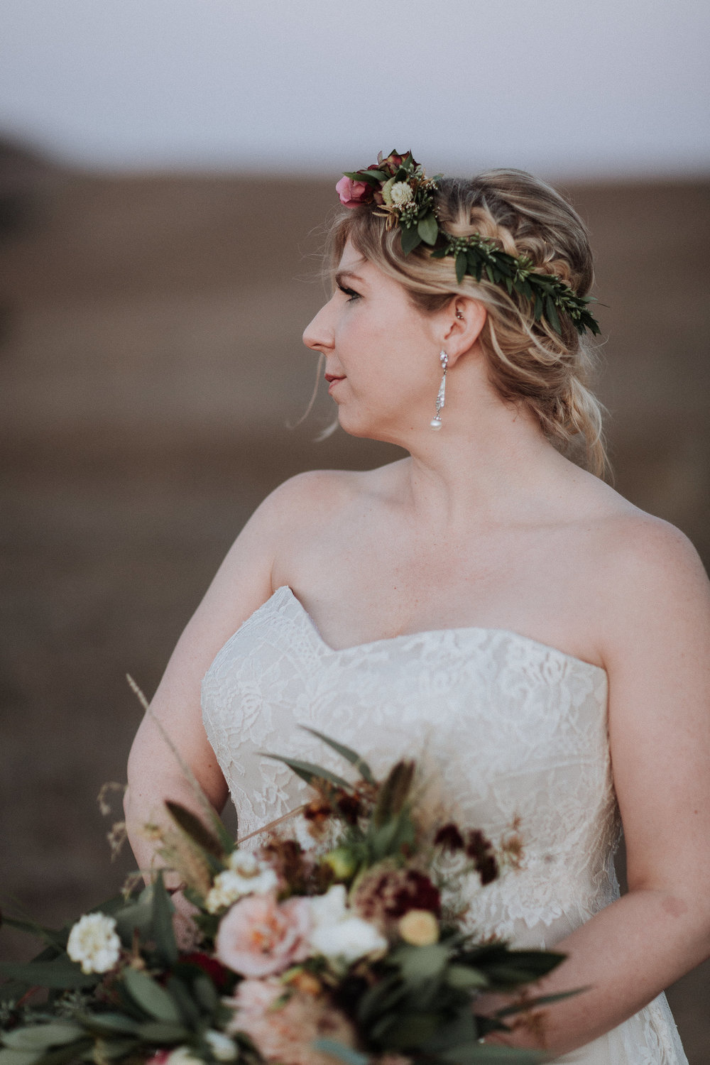 Minimal and elegant floral crown with pops of color and elegant greenery by Venn Floral photographed by Gretchen Gause at Olympia's Valley Estate.