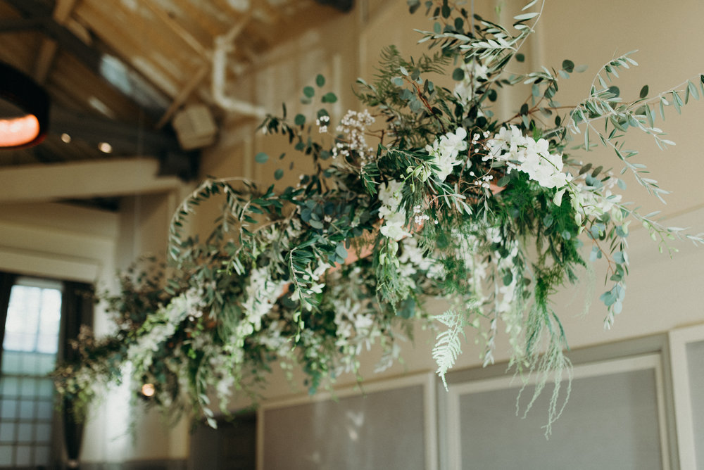 Hanging greenery installation for the head table in an organic style by Venn Floral at Cavallo Point photographed by Ryan Chard Smith with Lally Events.
