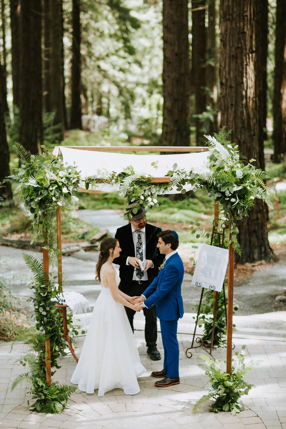 Elegant chuppah with lush greenery by Venn Floral photographed by Andria Lo at the UC Berkeley Botanical Gardens Redwood Grove with Lily Spruce.