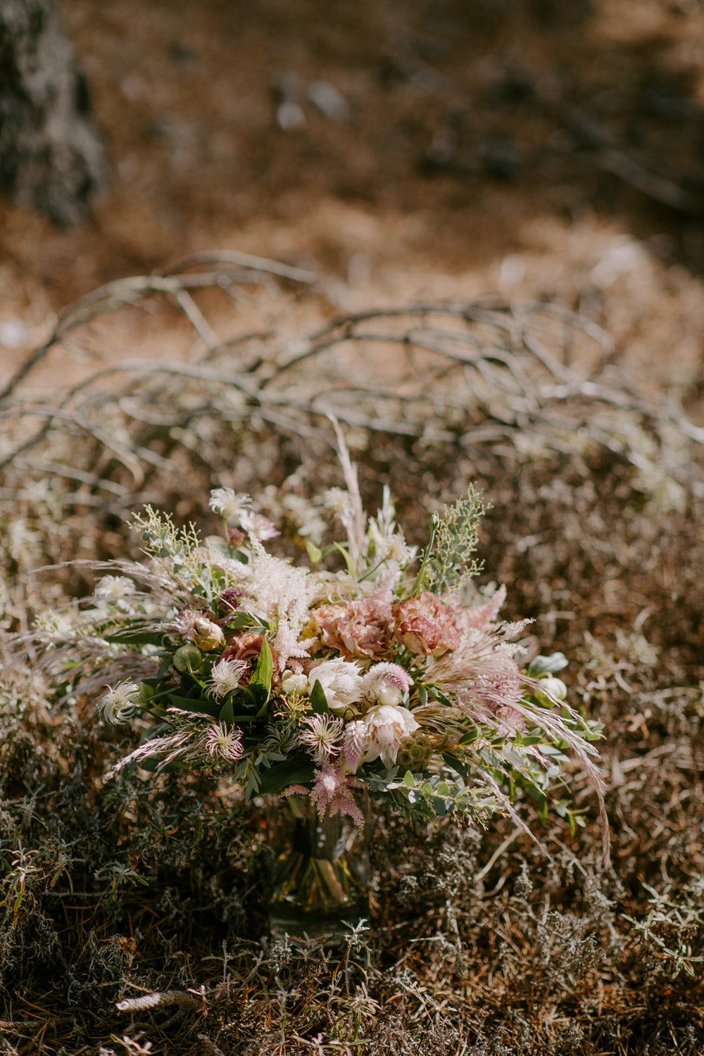 Modest wild bouquet with earthy blush and green tones by Venn Floral photographed by Kristen Marie Parker at Heritage House Resort in Little River, California.