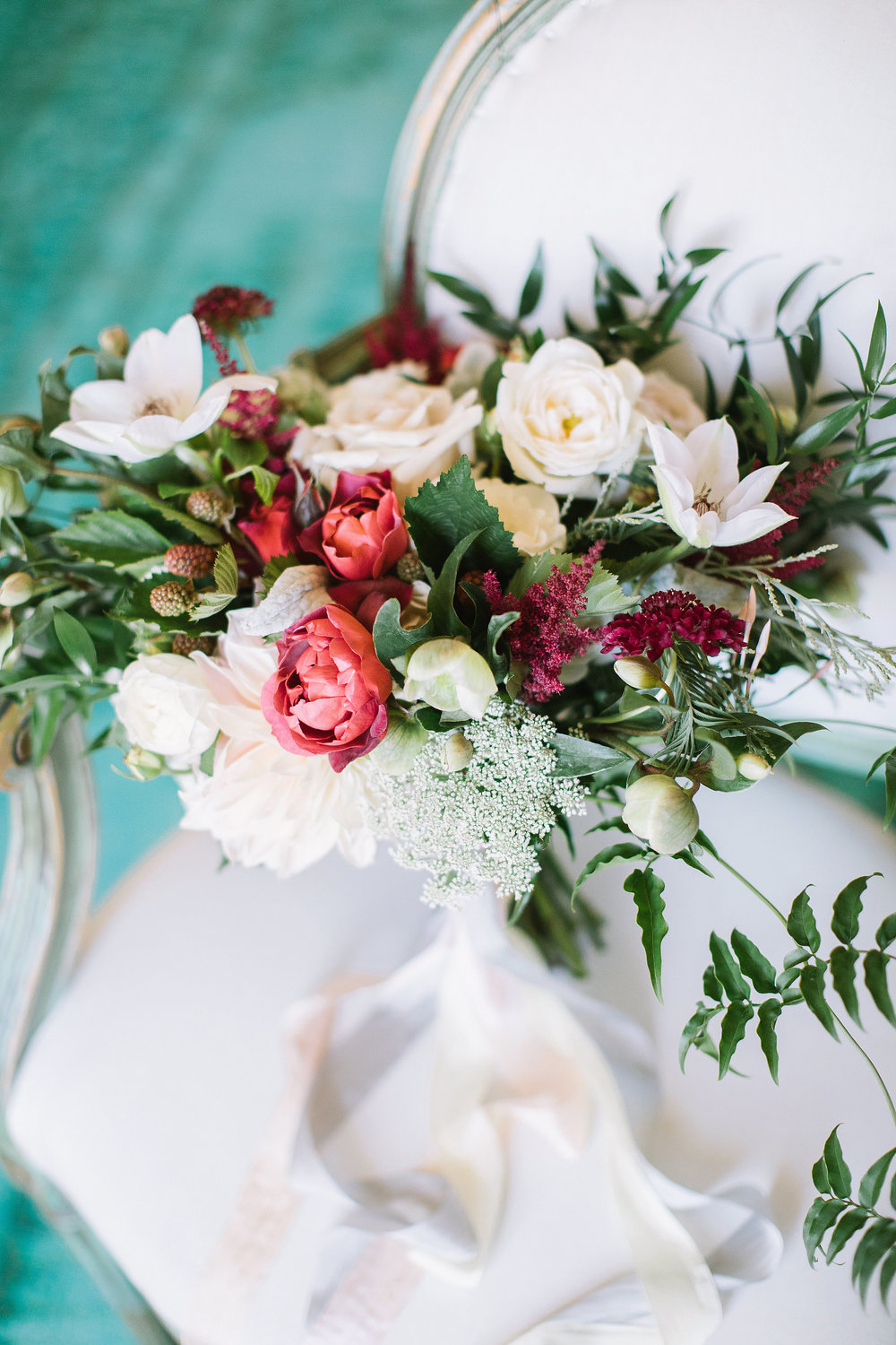 Whimsical bridal bouquet with hot cocoa roses, blackberries, clematis, and hellebores by Venn Floral photographed by The Edges at Olympia's Valley Estate with A Savvy Event.