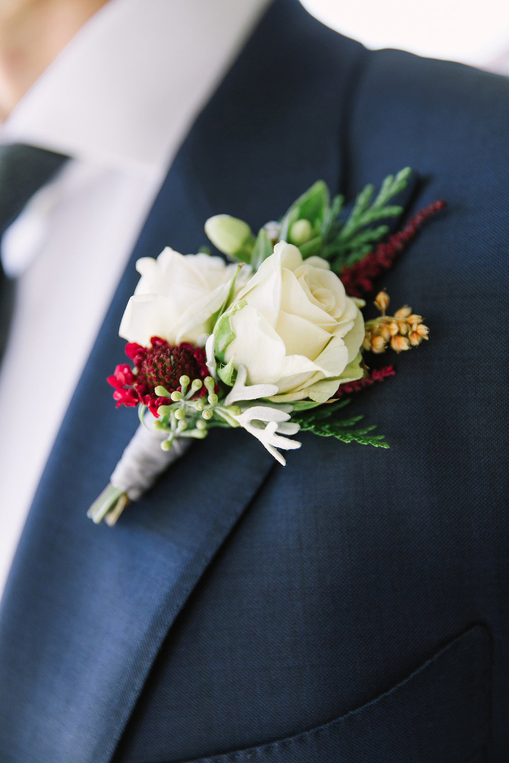 Gold, green, and burgundy boutonniere by Venn Floral photographed by The Edges in Petaluma, California at Olympia's Valley Estate.