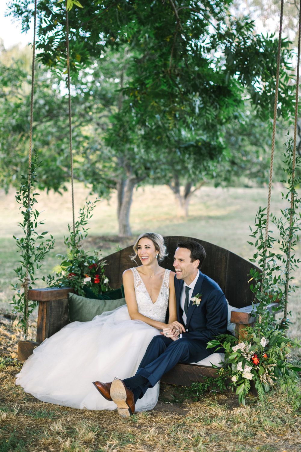 Boho wedding swing with flowers and vines by Venn Floral at Olympia's Valley Estate photographed by The Edges in Petaluma.