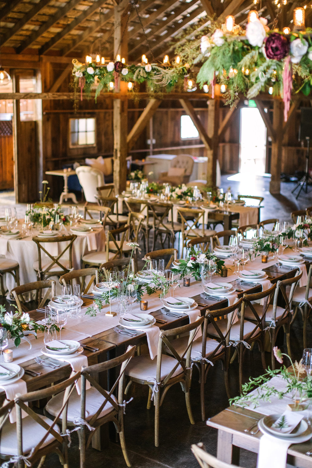 Wedding reception barn at Olympia's Valley Estate with floor to ceiling flowers by Venn Floral photographed by The Edges.