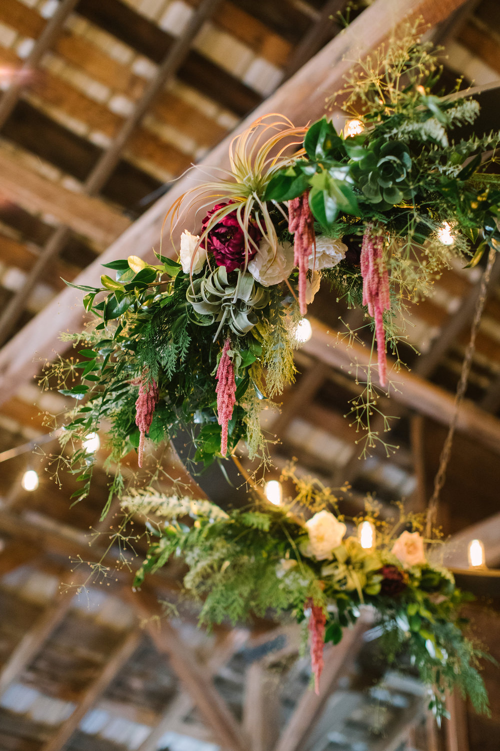 Greenery flower chandelier with Peonies, Roses, Amaranth, and Tillandsia by Venn Floral for an elegant barn wedding at Olympia's Valley Estate photographed by The Edges.