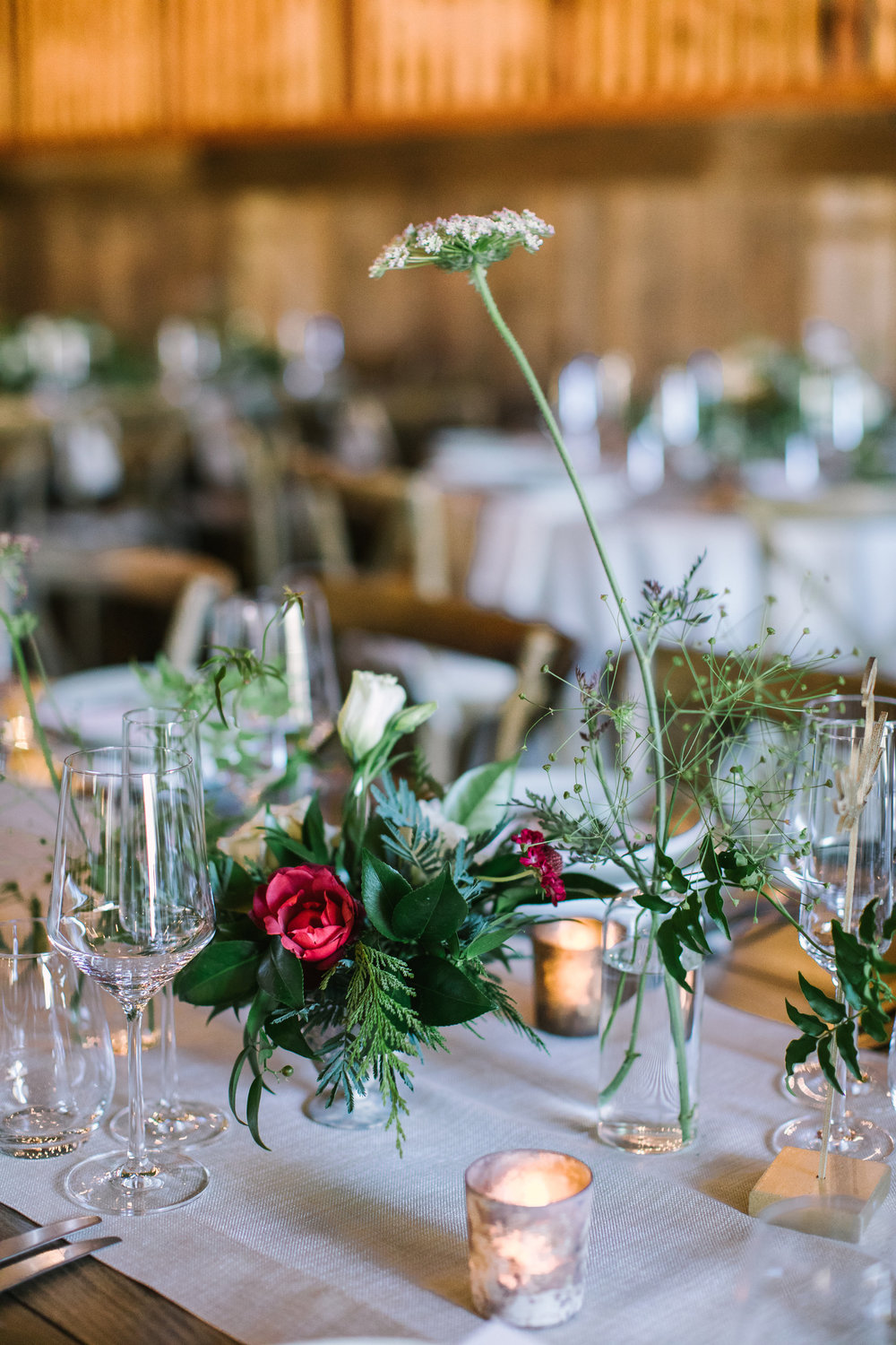 Bud vases with vines and flowers for an elegant barn reception at Olympia's Valley Estate by Venn Floral photographed by The Edges.