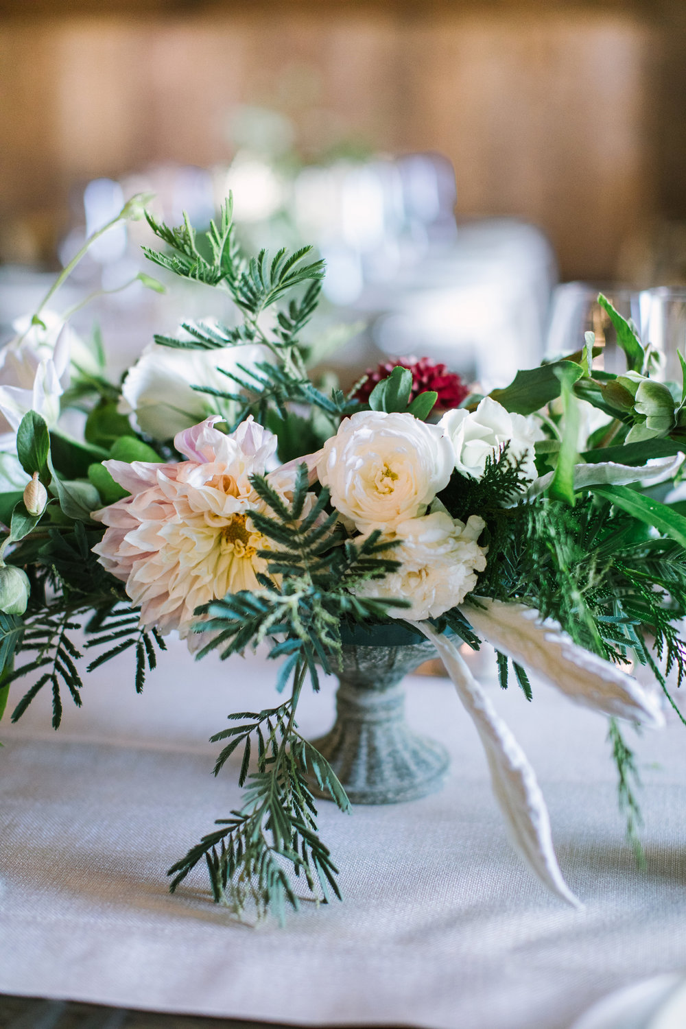 Low compote centerpiece with dahlias, roses, vines, and berries by Venn Floral T Olympia's Valley Estate photographed by The Edges.