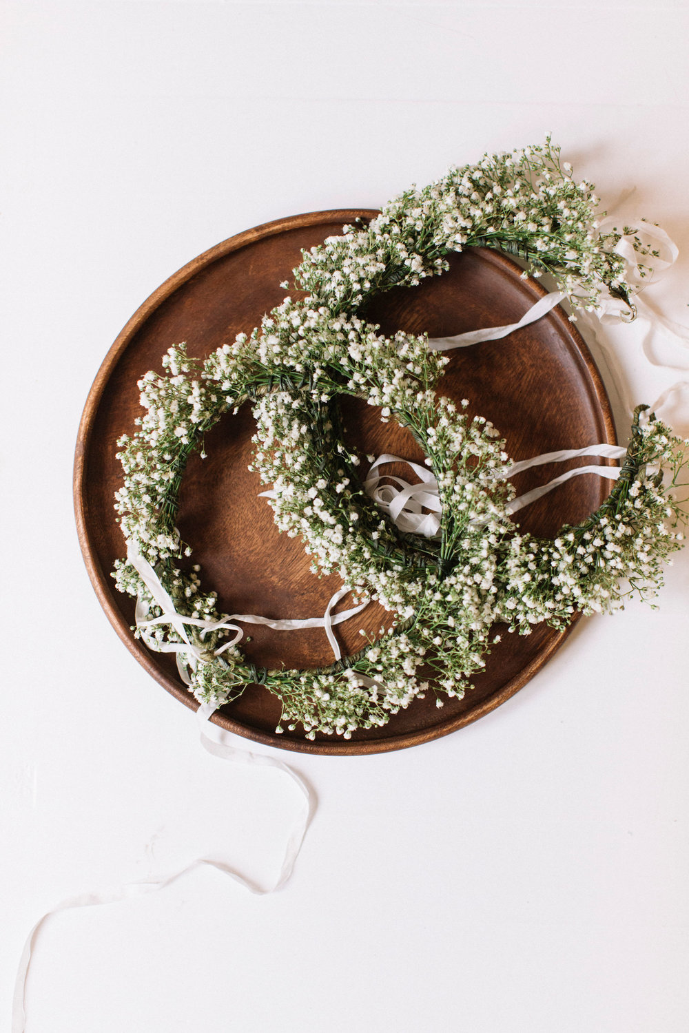 Light and airy flower crowns by Venn Floral photographed by Lucille Lawrence for a Healdsburg Wedding.