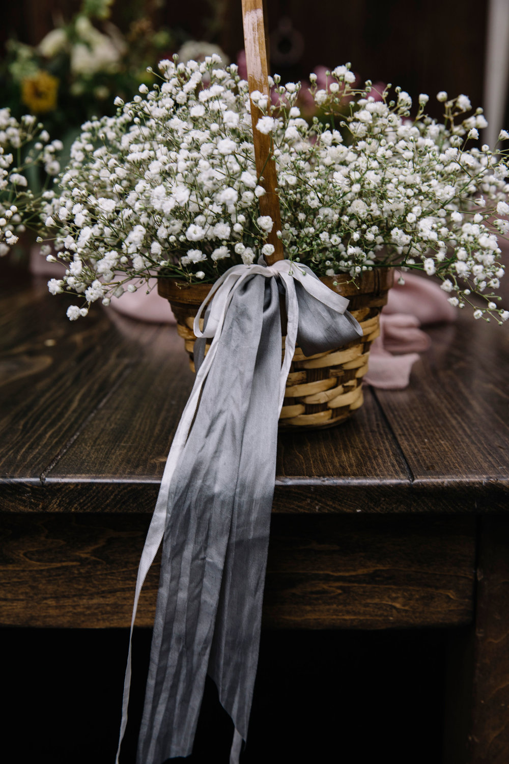 Natural flower girl basket by Venn Floral photographed by Lucille Lawrence for a Healdsburg wedding at Ru's Farm
