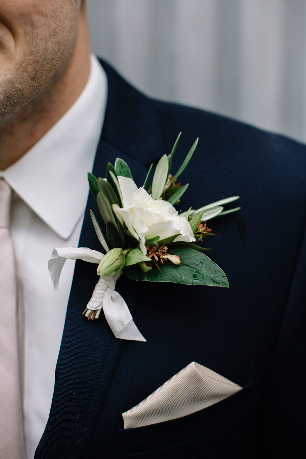 Handsome groom's boutonniere  with olive, hellebore, and rose by Venn Floral photographed by Lucille Lawrence in Northern California at Ru's Farm