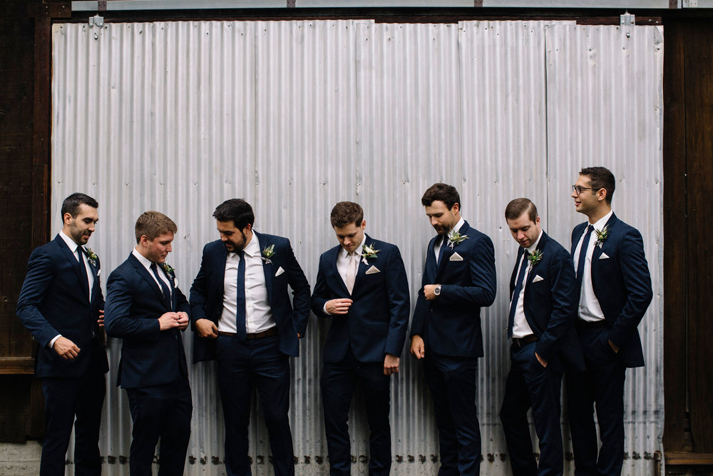 Handsome groomsmen with greenery boutonnieres by Venn Floral photographed by Lucille Lawrence in Healdsburg at Ru's Farm