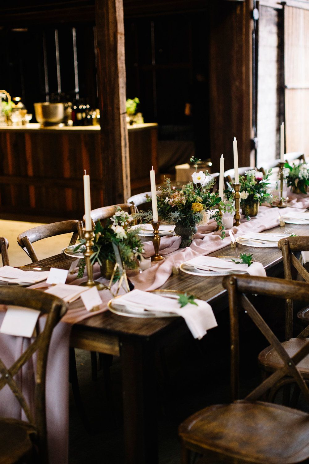 Antique wedding inspiration with lush and natural centerpieces, lots of greenery, and vintage touches by Venn Floral in Sonoma County photographed by Lucille Lawrence