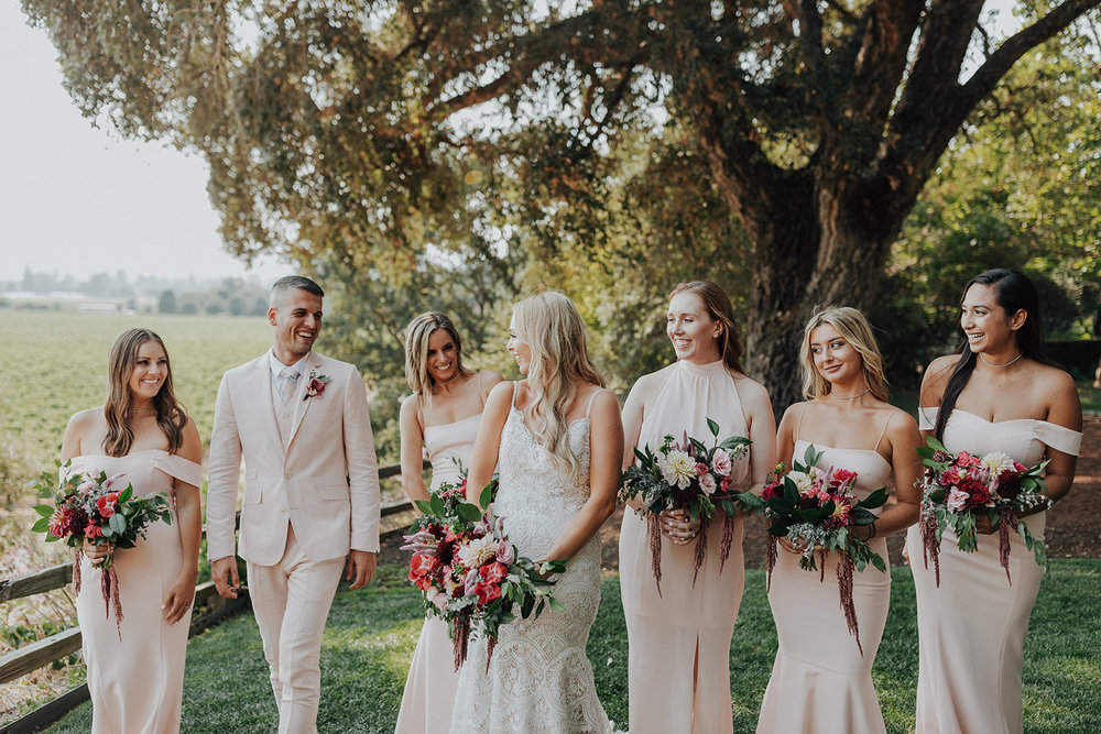 Vibrant and natural bridal bouquets with lots of bright color by Venn Floral in Healdsburg at Ru's Farm photographed by Logan Cole.