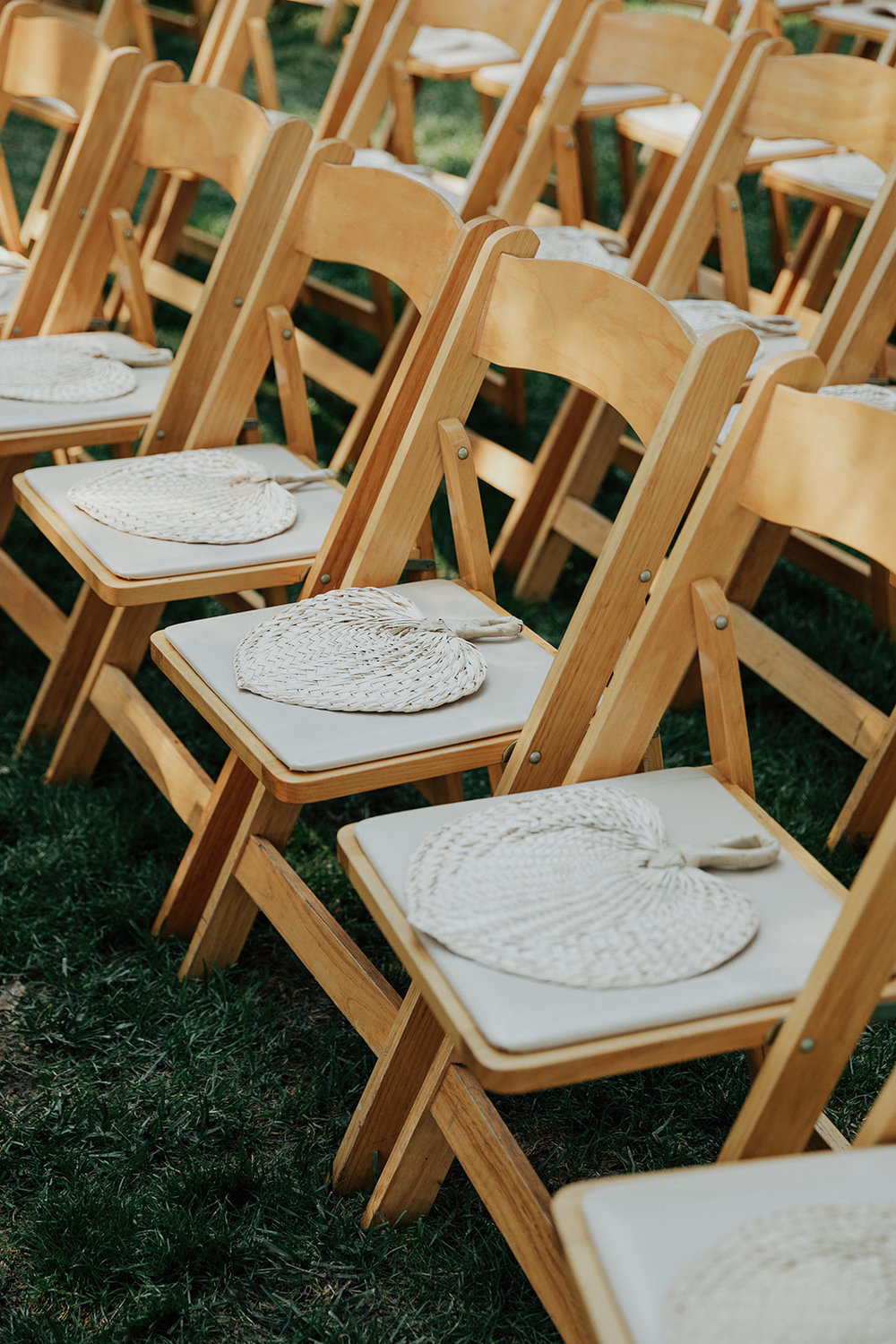 Summertime wedding ceremony fans with Venn Floral in Healdsburg at Ru's Farm photographed by Logan Cole.