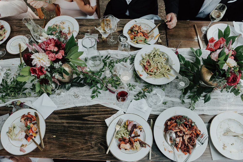 Colorful, feastly tablescape for a vibrant wedding celebration by Venn Floral at Ru's Farm photographed by Logan Cole.