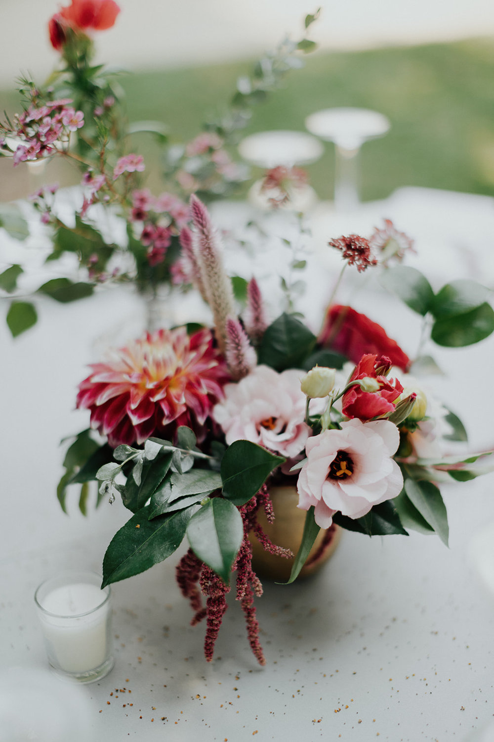 Hot pink, blush, and coral centerpieces in gold vases. Healdsburg wedding flowers by Venn Floral at Ru's Farm photographed by Logan Cole.