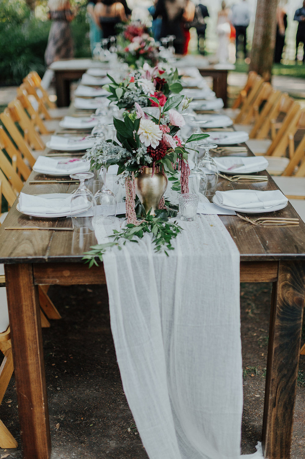 Bridal bouquets in gold vases and greenery runner for the head table. Healdsburg wedding flowers by Venn Floral at Ru's Farm photographed by Logan Cole.