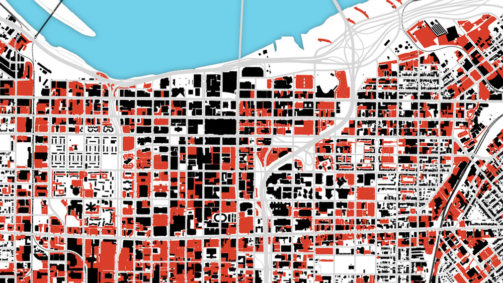 This map illustrates the amount of surface lots and vacant hardscape spaces in and around the central business district in Louisville, KY. The black shapes indicate buildings and red are surface lots that present opportunity to reweave the urban fabric and create a stronger, more walkable, and more vibrant city.