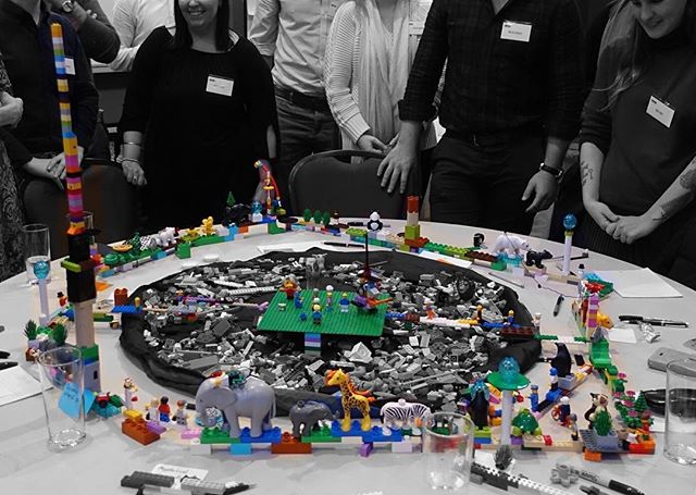 """Sometimes groups go rogue, ignore instructions and build crazy structures encircling and spanning the entire table.  But that's creativity, that's LEGO Serious Play. You never know what groups will come up with. What crazy build will tell their story…  The question was: """"What are the key characteristics that your team needs to succeed in this world?"""" #LegoSeriousPlay #creativity #innovation #LEGO #metaphor #workshop #facilitation #meetings #story #hand #play #storytelling #team #success"""