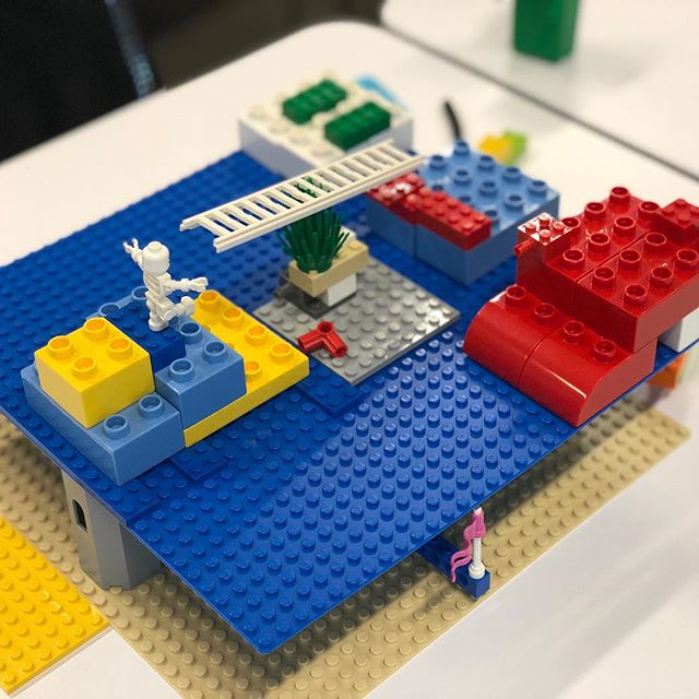 "Next level 3D building. A baseplate held up over another baseplate.  This shared model represented the challenges facing IKEA (perspective from outside the company). What you can't see underneath is the internal problems, that are the ""underlying foundation"" of the problems we see on the outside.  Another inventive way to represent complex issues with LEGO Serious Play.  #LegoSeriousPlay #GeneralAssembly #creativity #innovation #LEGO #metaphor #workshop #facilitation #meetings #story #hand #play #storytelling"