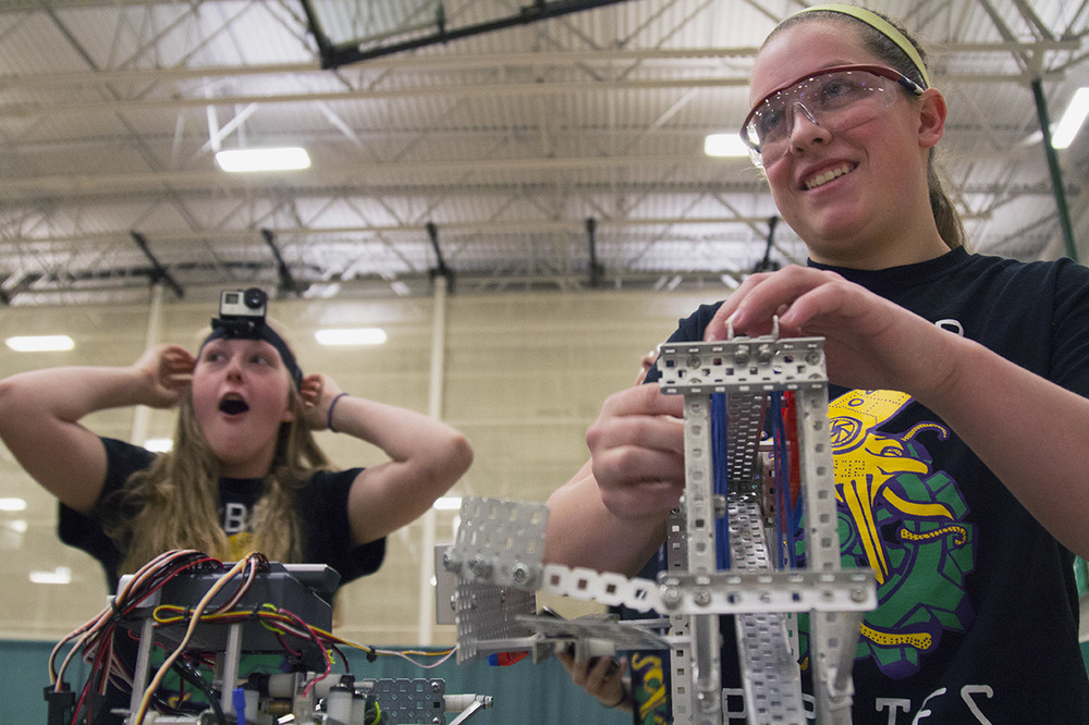 From left, Kaitlyn De Kan, 17, and Allie Floyd, 18, make final checks to their robot before they compete during the VEX Missouri State Robotics Championship in Rolla on Saturday. Kaitlyn expresses her excitement after receiving a GoPro from another team.