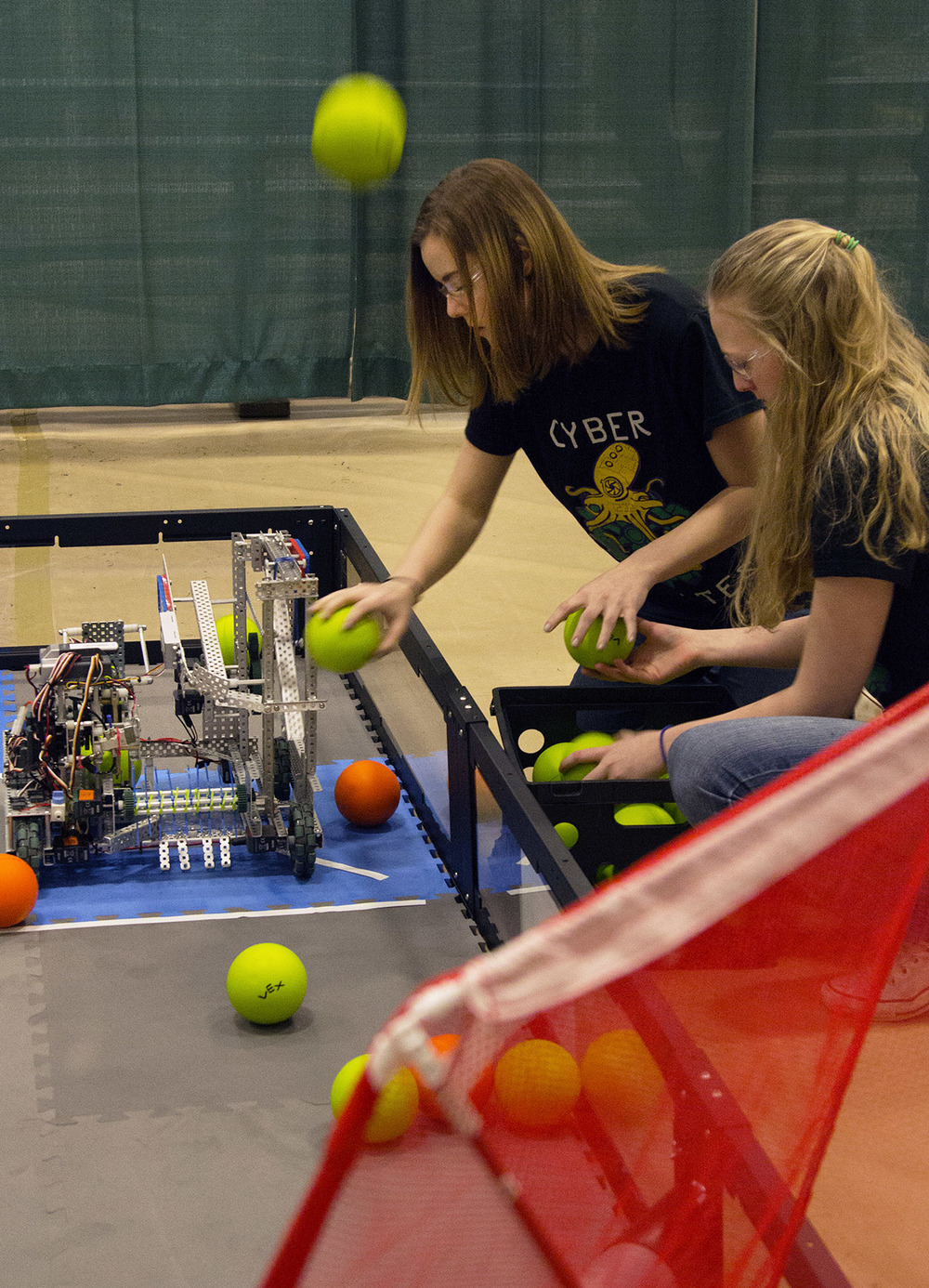 From left, Hannah Engler, 15, and Kaitlyn De Kan, 17, add styrofoam balls to their robot during the VEX Missouri State Robotics Championship in Rolla Saturday, Feb. 20, 2016. The purpose of their robot was to shoot as many balls into the net as it could before time ran out.