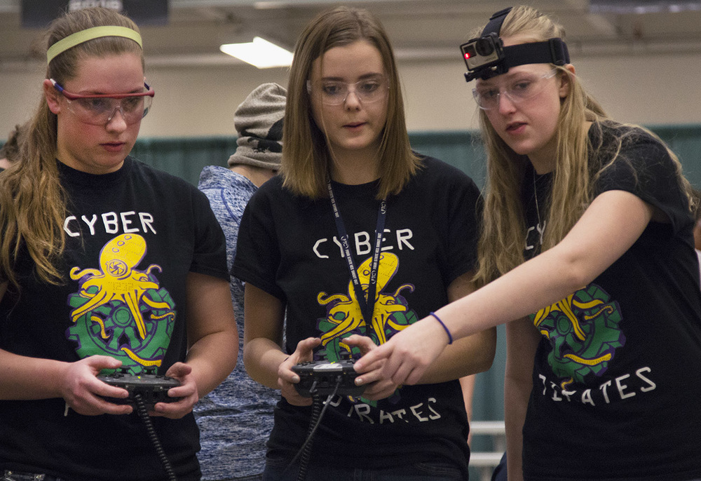 From left, Allie Floyd, 18, Hannah Engler, 15, and Kaitlyn De Kan, 17, strategize during their competition at the VEX Missouri State Robotics Championship at Rolla on Saturday. Their group, the Cyber Pirates, have four members but only three are allowed on the competition floor at a time.
