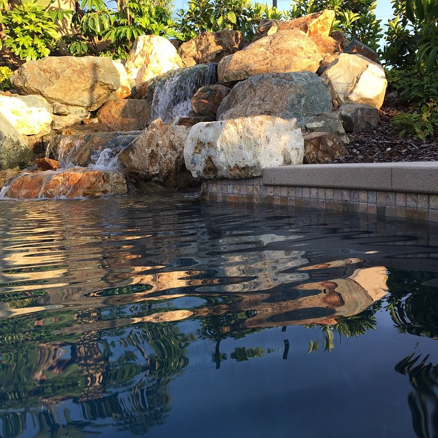 Natural rock waterfall set into pool.