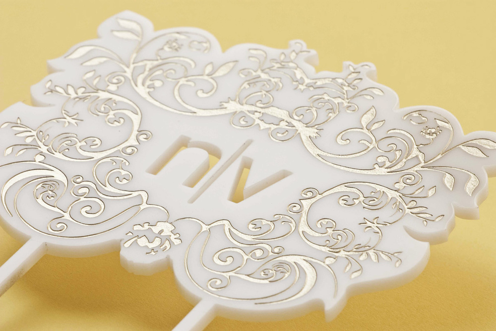 Laser cut and engraved wedding cake topper. The engraved part was painted gold Size: 6X12.