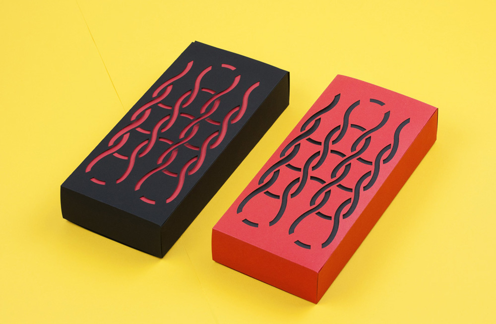 Laser cut paper boxes for a necktie line.
