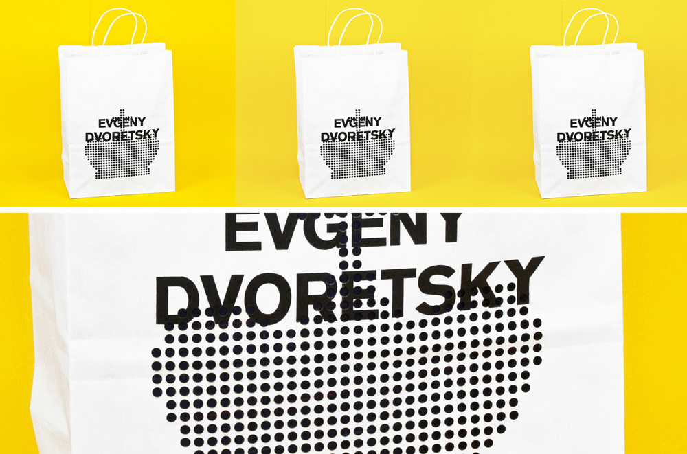 Laser cut paper shopping bag for Evgeny Dvoretsky clothing company.