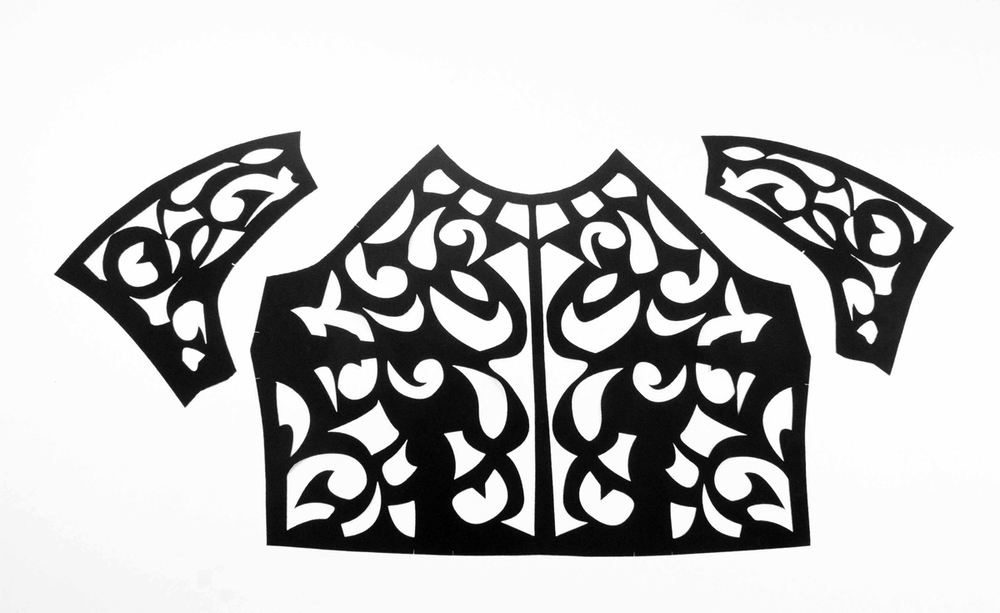 Laser cut upper part of a dress with sleeves for Michael Alan Stein clothing company. Material: polyester.