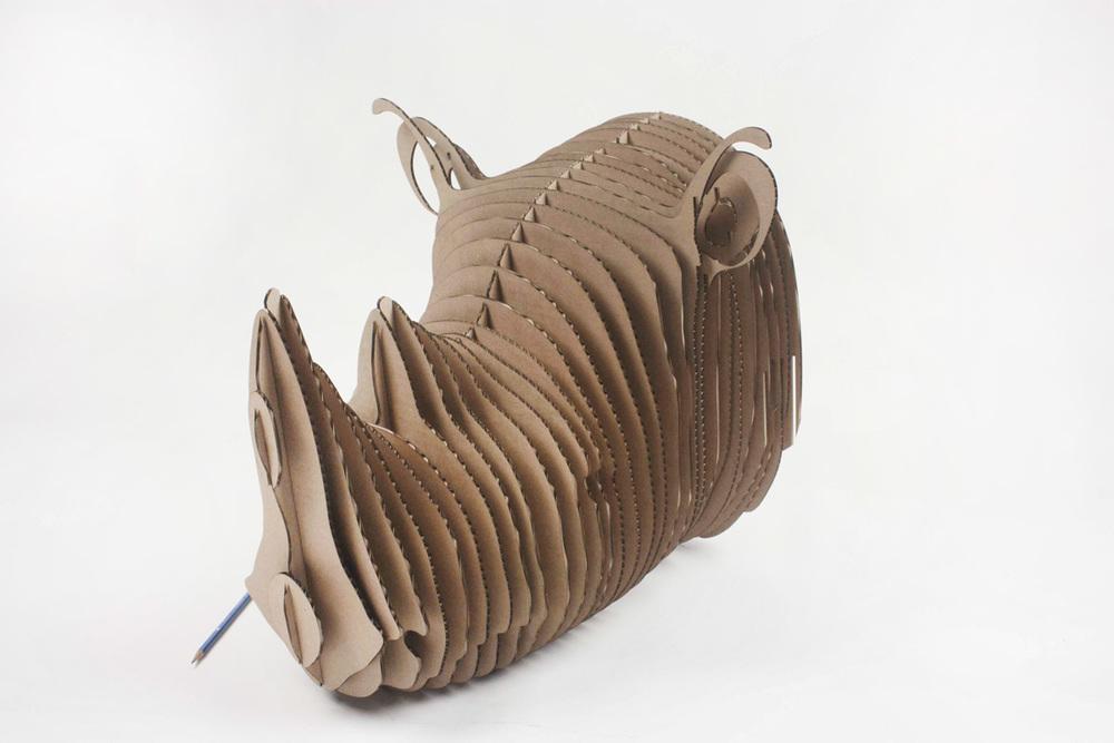 Laser cut cardboard rhino.
