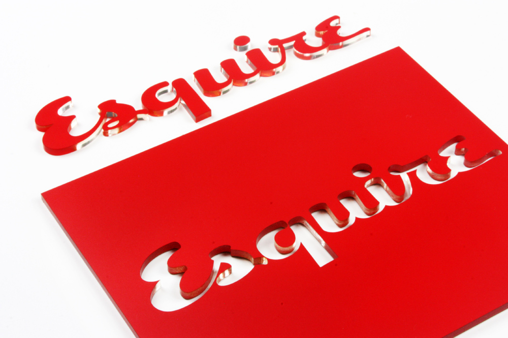 Laser cut acrylic sign with red vinyl on the top.