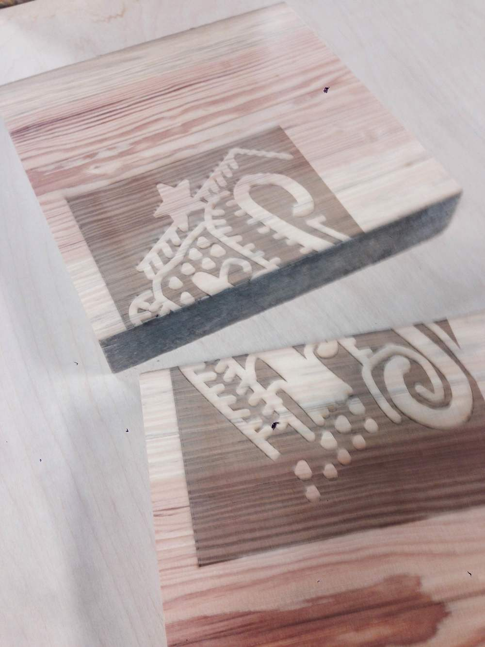 Laser engraving on reclaimed wood.