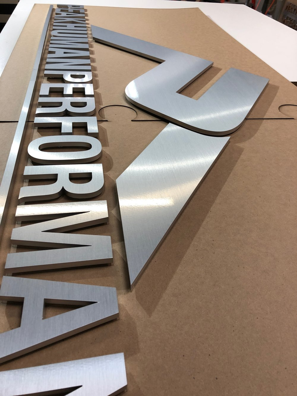 laser cut brushed aluminum sign