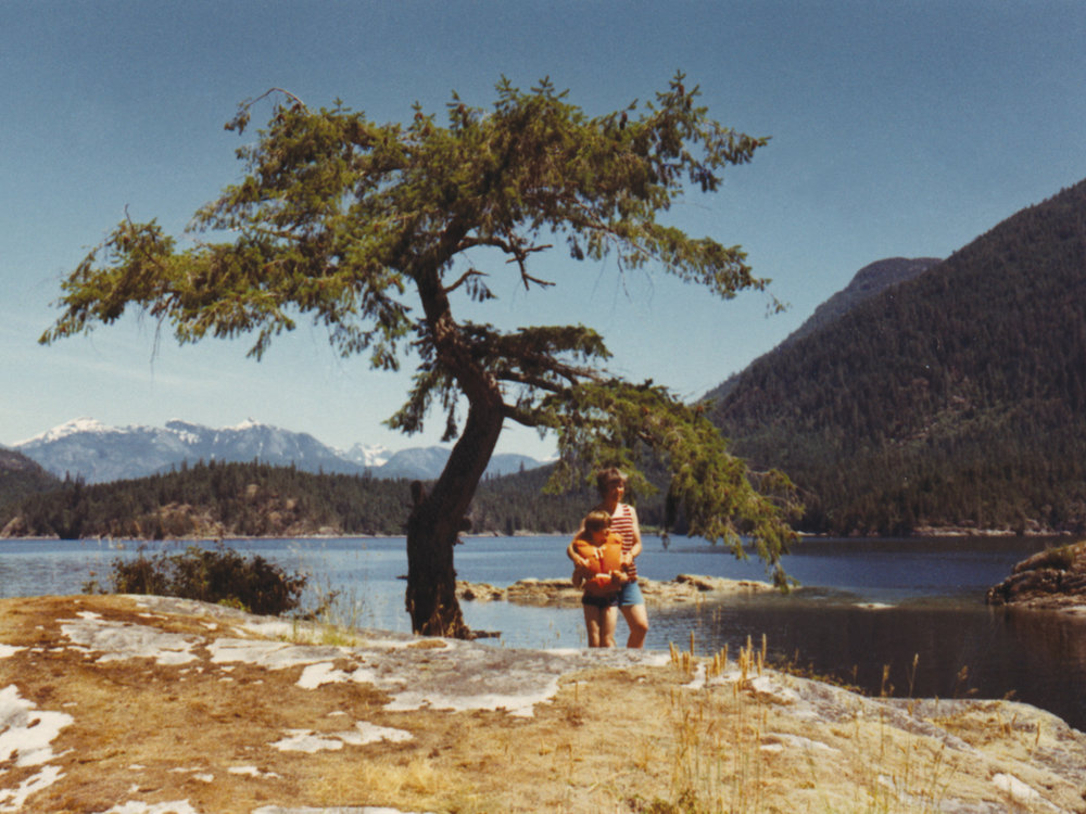 This photo is of me and my mother, circa 1971, taken at Isabel Bay, Desolation Sound, B.C. Canada. We're standing on the smaller of two small islands that create this safe haven for wildlife and yachtsmen to enjoy, with Theadosia Arm and Lancelot Inlet behind us, and next to the beautiful, lone tree that is my logo. A place, a tree and   the most special person   who inspired and made possible, my life of art and creativity.
