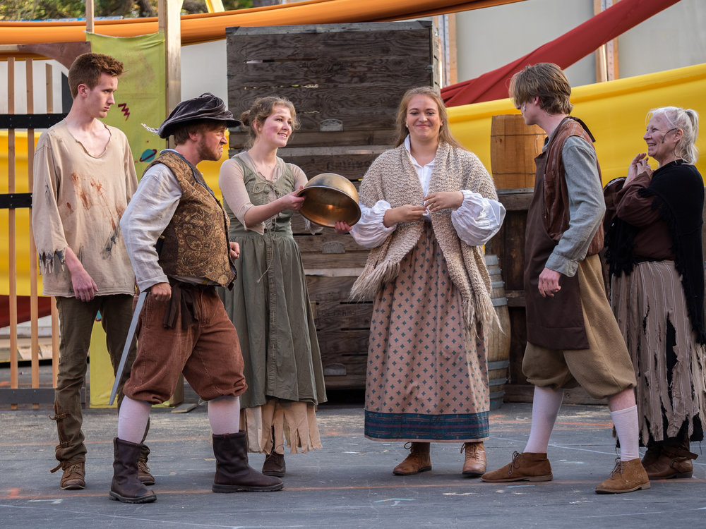 "(Left to right) Alex Thibbeau, Collin Skerritt, Dani Heimer, Audrey Moonan, Ty Barrett, and Linda Felice cant help but laugh during ""Golden Helmet of Mambrino"" in Man of La Mancha."