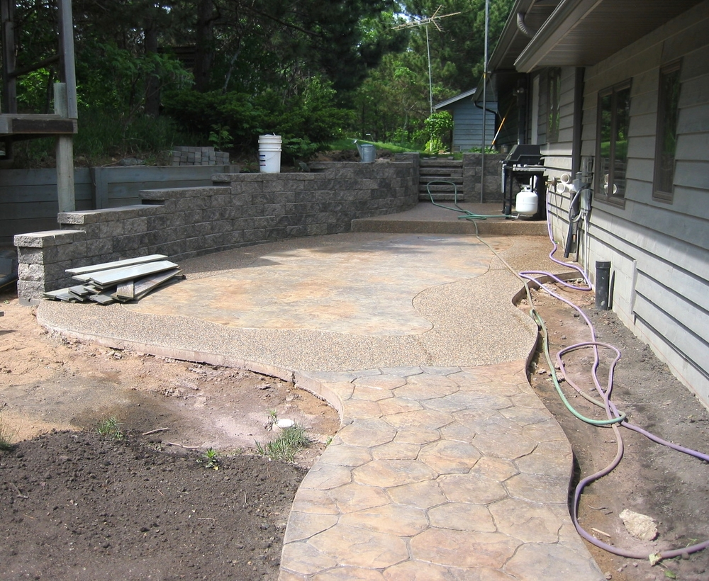 Stamped Patio with Retaining Wall