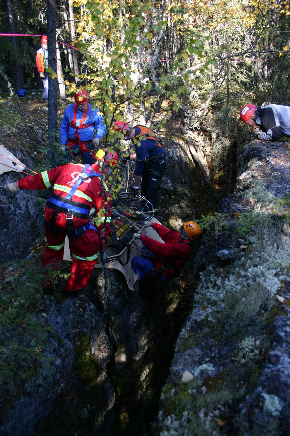 Rope rescue team members practice rescuing from a crevice.