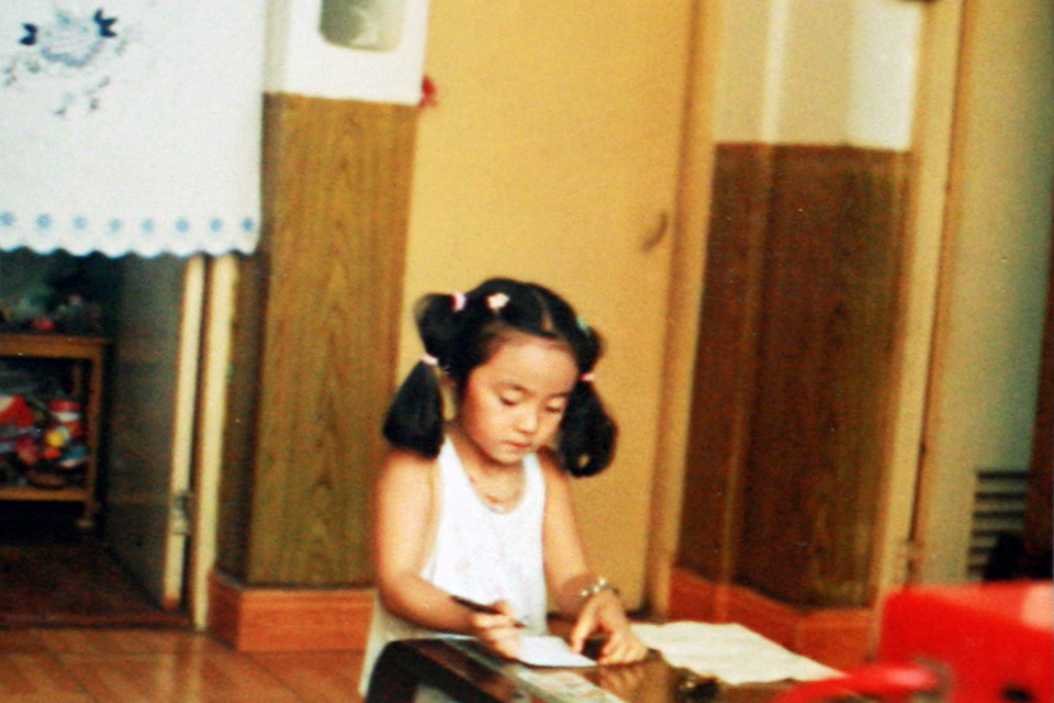 6-year-old me in my grandparents' living room, probably drawing