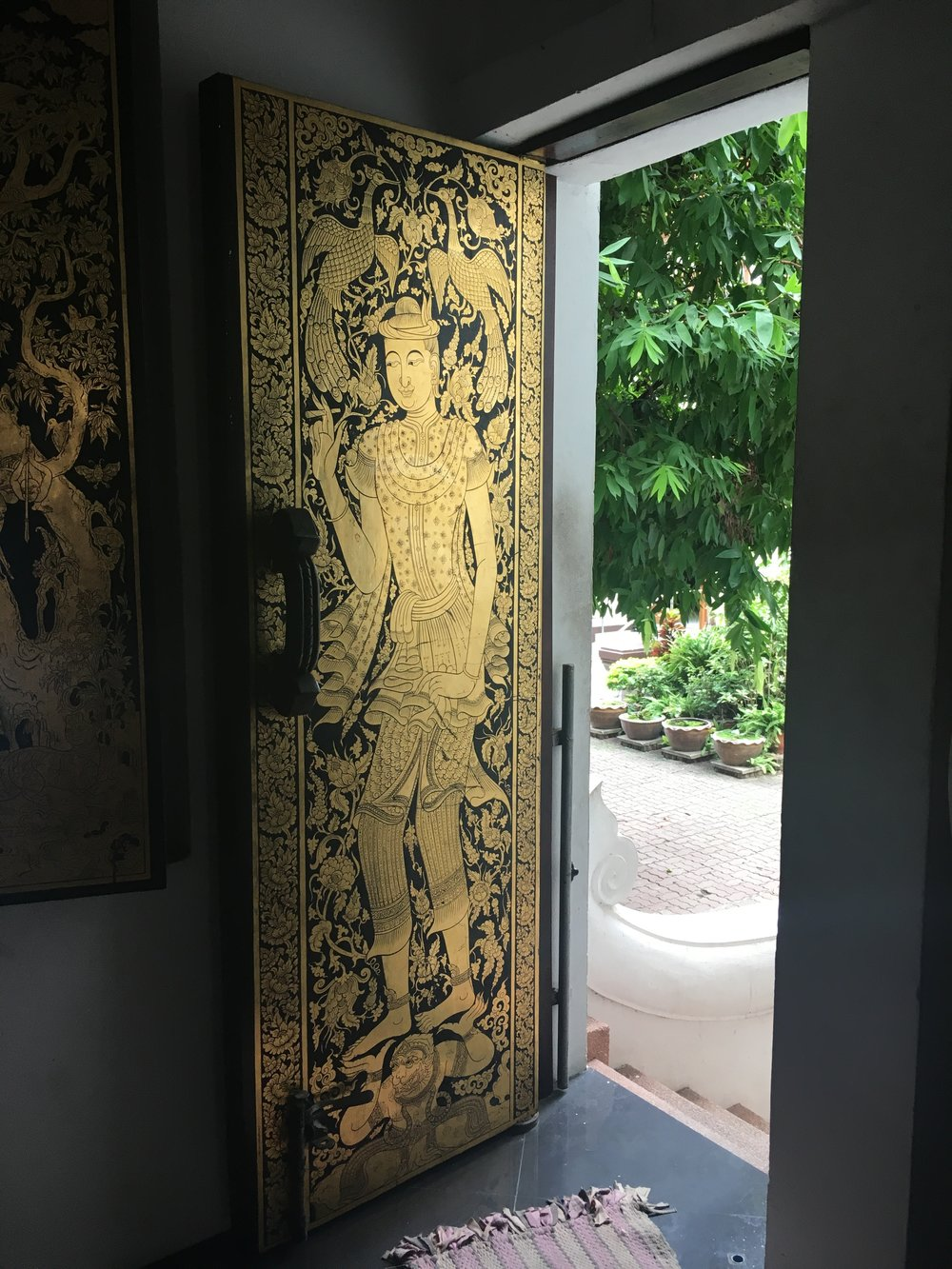 Good and black lacquered door in a temple.