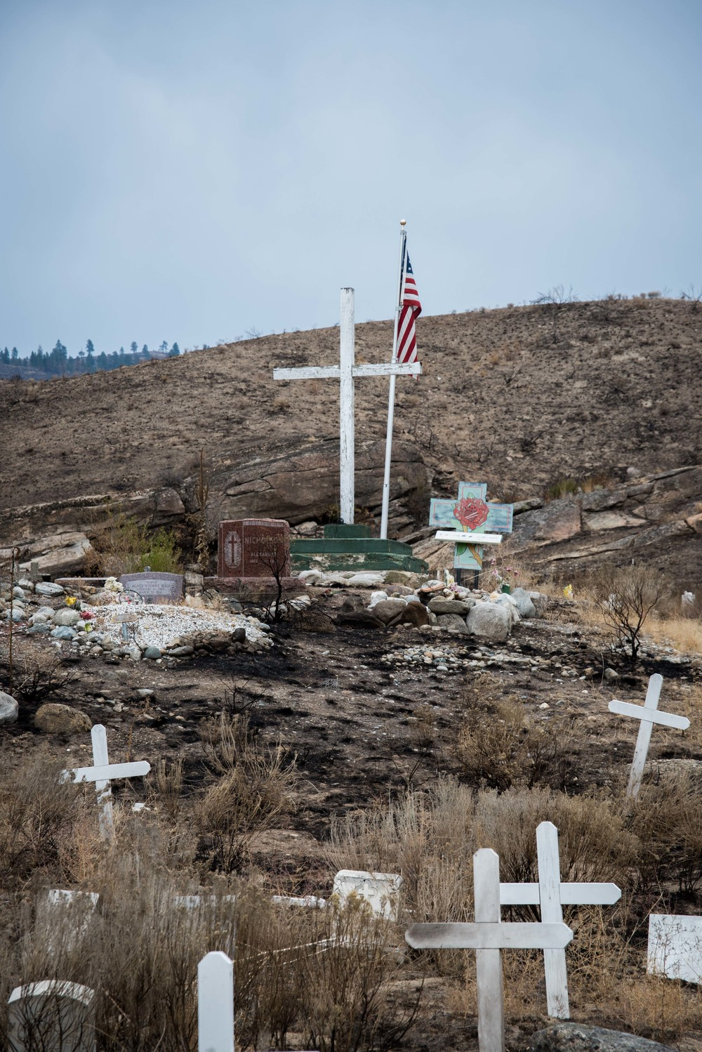 Wildfire passed through cemetery at St. Mary's Mission at the Colville Indian Reservation near the Okanogan Complex and North Star fires in North Central Washington.