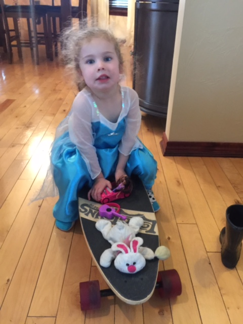 Reagan in her Elsa Dress on our Longjohns Longboard.  #LongJohnsLongboards